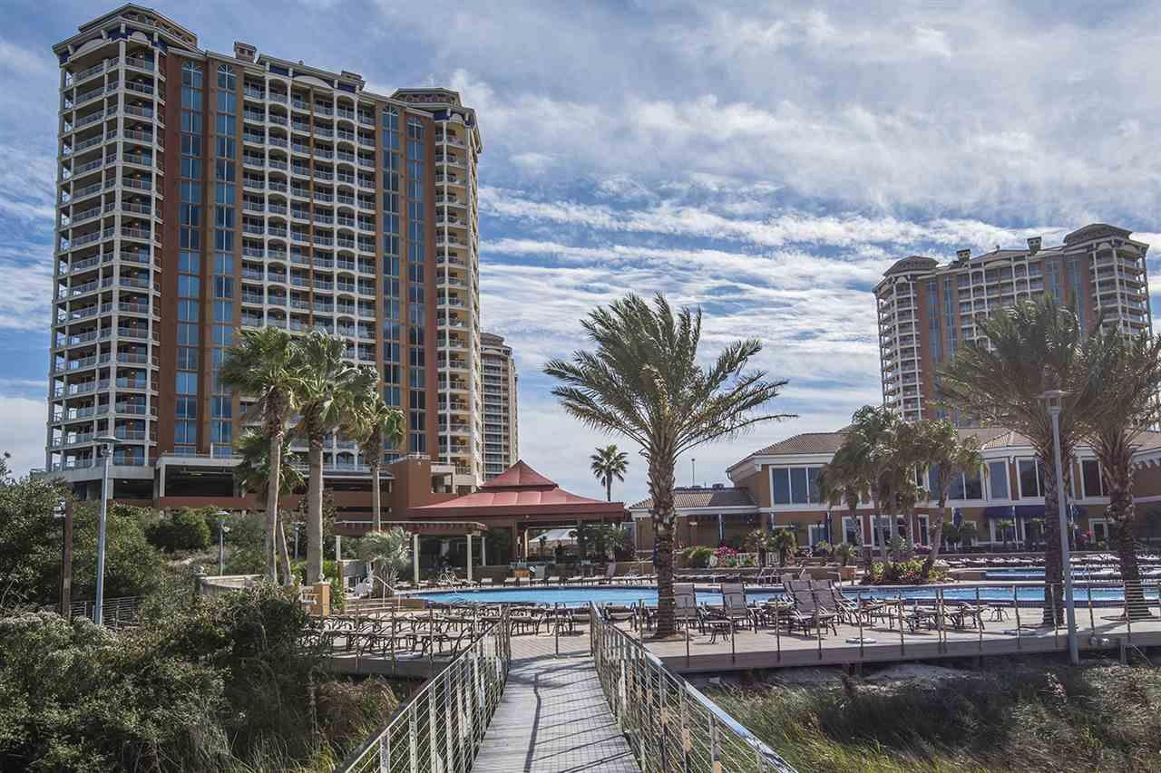 There is no place on Pensacola Beach like Portofino Resort! Portofino is a Mediterranean inspired Resort that is made up of five condominium towers, Lifestyle Center, Rubico Tennis Court, Indoor Olympic size pool nestled on the Intercoastal Waterway. This unit has it all! Starting with the Magnificent views of the Gulf of Mexico and the Intercostal Waterway which are awe-inspiring from your private balcony. As you enter the unit you will immediately notice the 9 foot Ceilings as it gives the unit a feeling of openness. The windows throughout the unit go from the floor to the ceiling and gives each room a nice balance of Natural Light. The windows throughout give amazing views of the open space of the Gulf of Mexico. This unit offers a beaut