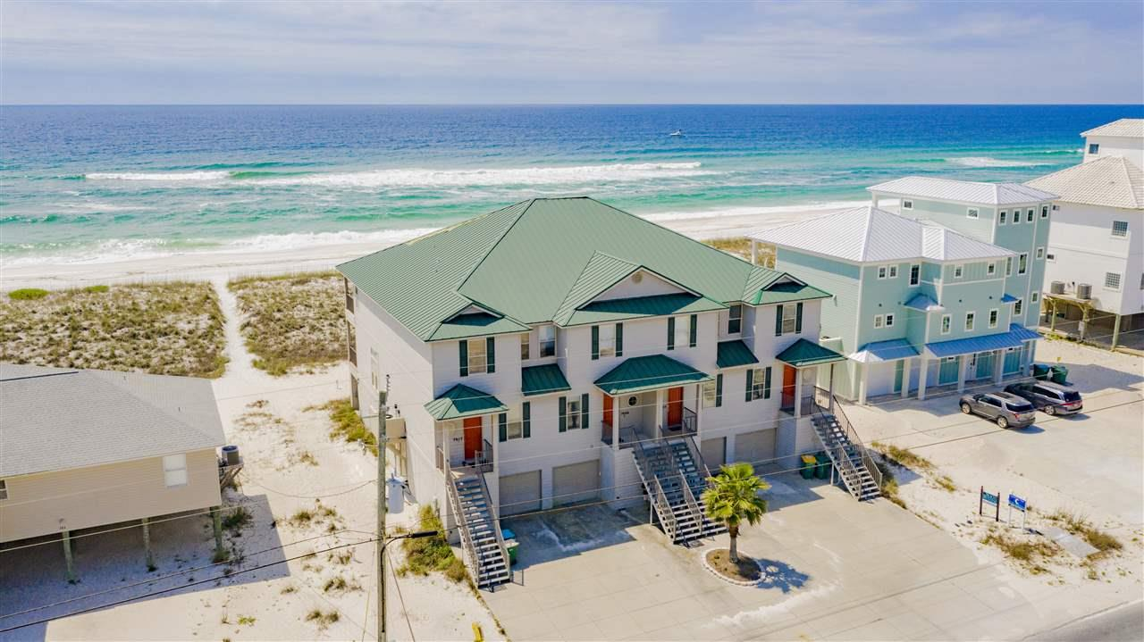 This 4 bedroom, 3 bathroom tastefully furnished Gulf front townhouse is a great investment opportunity. With income of $74,282 in 2019, $82,421 in 2018, and over 80 5 star reviews. This well maintained unit is rental ready with bookings already on the calendar and sleeps 12 people comfortably. The kitchen comes fully equipped with custom cabinetry, granite counter tops, stainless steel appliances, ice maker, pantry and breakfast bar. You'll enjoy the open floor plan with high ceilings, giving for a nice spacious feel. The living room has floor-to-ceiling windows offering Gulf views. The large balcony has a staircase to the ground floor with direct beach access. Upstairs, you'll find the Gulf front master with a large private balcony overlooking the Gulf. The master suite has a coffee bar and the master bathroom has a jetted tub, separate walk-in shower, his-and-hers vanities, water closet, walk-in closet and owner's closet. There are 2 additional bedrooms and a full bathroom upstairs. On the main living floor, you'll find an additional bedroom and bathroom. The over-sized garage can fit 3 vehicles and opens up to the back yard where you can enjoy the outdoor shower. Other notables are room energy efficient room darkening Levolor blinds throughout, flat screens in every bedroom, hair dryers and bathroom soap dispensers installed in every bathroom, electric fireplace, crown molding and recessed lighting. Dining area with table seating for 8 people and seating for 5 at breakfast bar. Unit also comes equipped with 6 bikes, a plethora of beach goods and toys and a gas grill. Convenient sandy area located just at the bottom of the stairs which many guest enjoy who have small children. Come and enjoy all Navarre beach has to offer such as the sea turtle rehab center, breathtaking National Seashore, Navarre pier and bike path. Check out our full video tour on the MLS and YouTube and the Matterport tour on the MLS.
