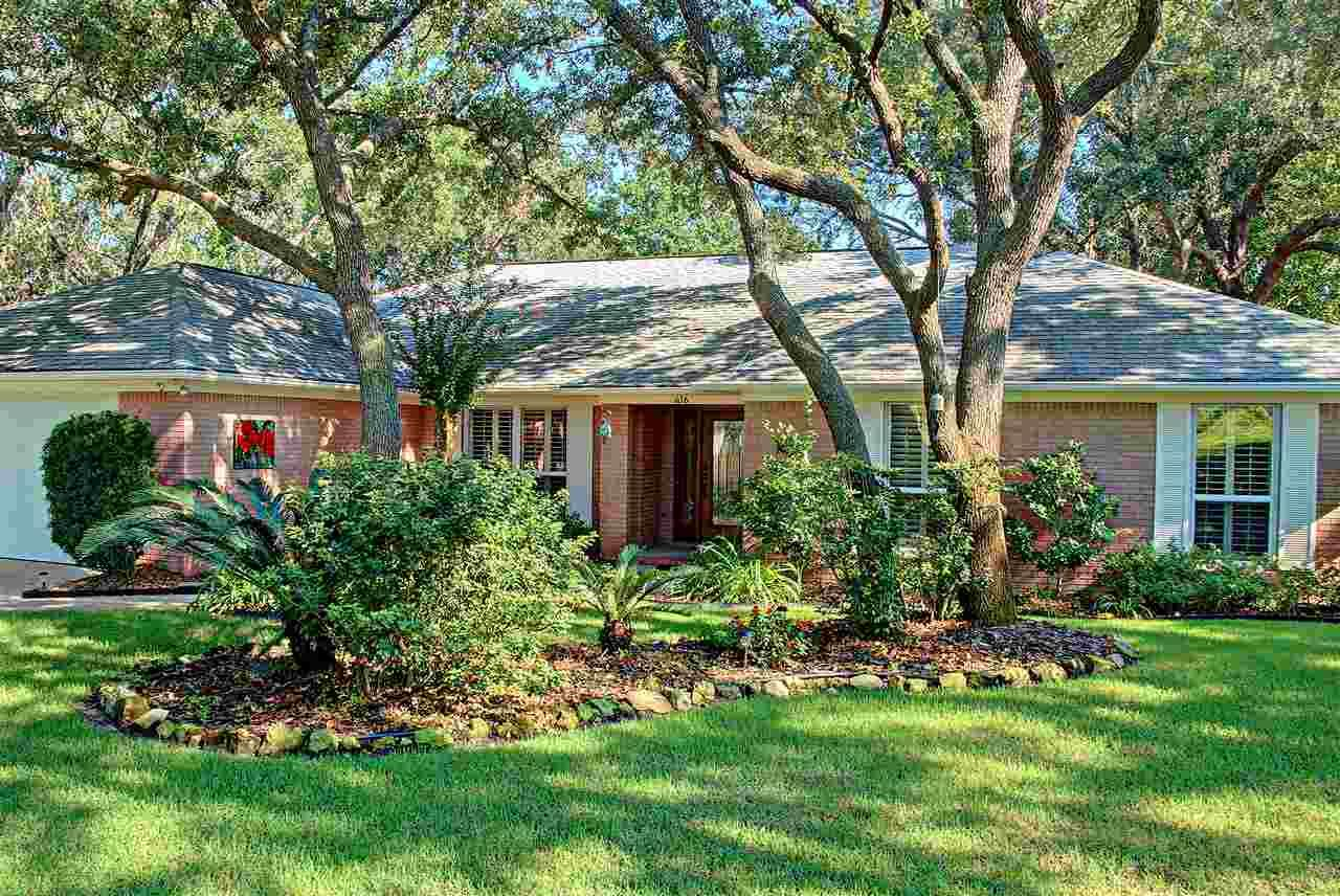 Peace of mind - never flooded, protected from wind and whole house generator.  Groomed yard with edged beds, stately oaks, magnolia, crepe myrtle trees AND the inside is as beautiful as the outside!   Wonderful location in the heart of Gulf Breeze Proper and move-in ready.  Welcoming foyer with a beautiful beveled glass front door that gives light and privacy. French doors to the formal dining room or perfect office.  Large open family room with fireplace, high ceiling and opens onto the deck to expand leisure activities to the out-of-doors.  You will be delighted with the kitchen.  White cabinets with soft close doors, gas range, granite counter, tile back splash and wall to wall storage!  Large breakfast nook with a bay window.  All floor