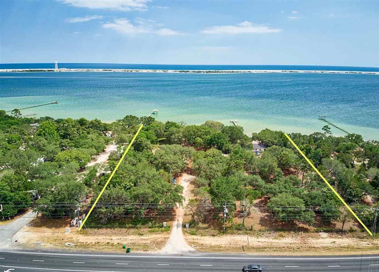Over 3 acre parcel of land that has over 300 feet of Sound Front!. This Commercial Zoned property, would allow a Hotel, restaurant, or an RV Park. There is also potential to have this property rezoned for a water front subdivision. Stop by today and see this one of kind lot located near to Navarre and Navarre Beach!