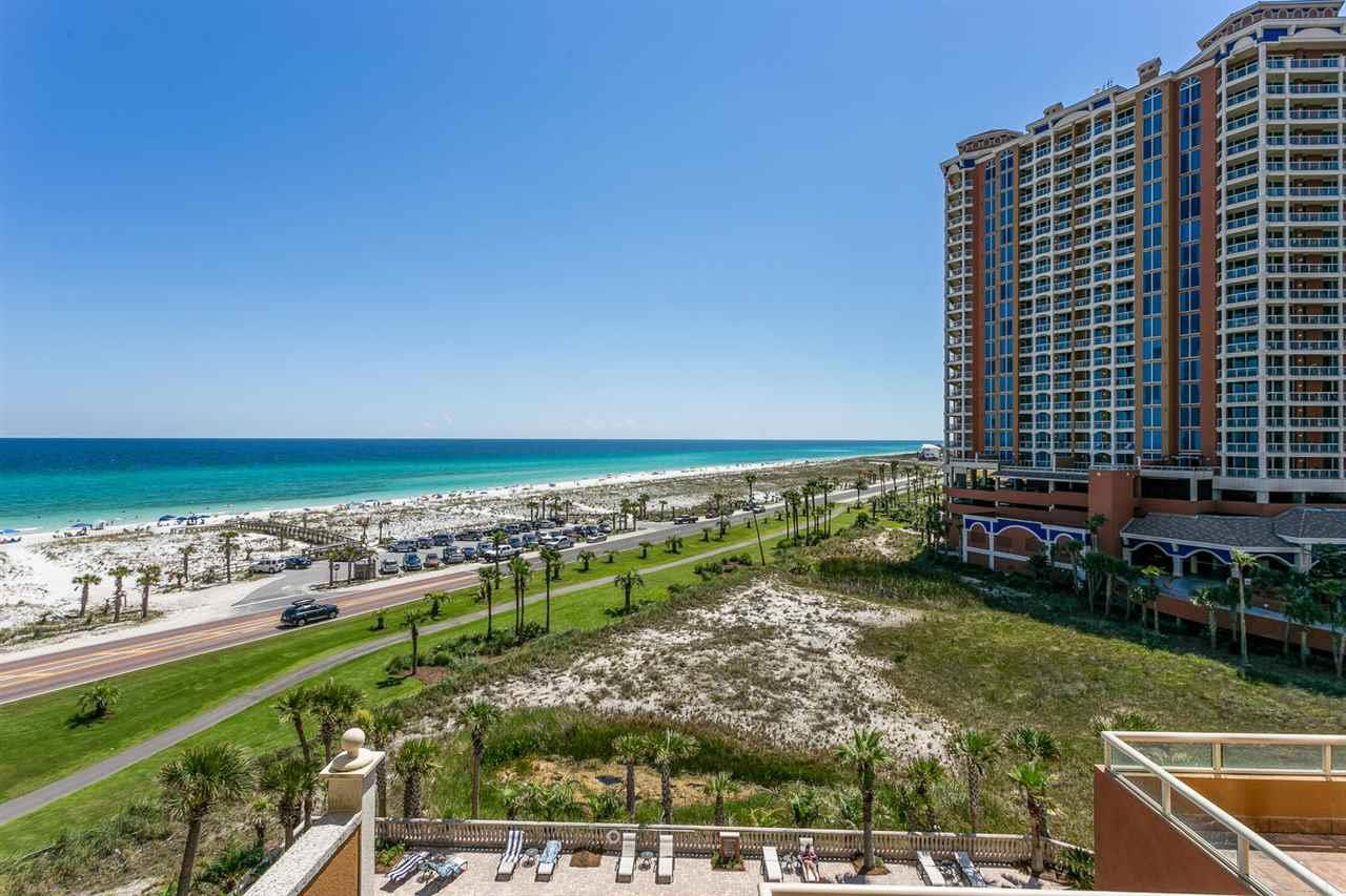 Beautiful Gulf views from every room of this highly desirable Tower 1 unit!  This unit is centrally located among the 5 towers of this amazing Mediterranean influenced resort.  Nestled on a barrier island between the sugar white beaches of the Gulf of Mexico and the Intracoastal Waterway, this is a PARADISE found!  This spacious updated unit has an open floor plan that features a large living area with floor-to-ceiling windows and doors to the balcony. The private balcony with outdoor grill can be accessed from every room. Large kitchen with granite countertops, backsplash and new refrigerator overlooks the dining area and breakfast bar.  The views are stunning from the master suite that has generous closet space, dual vanity with granite c