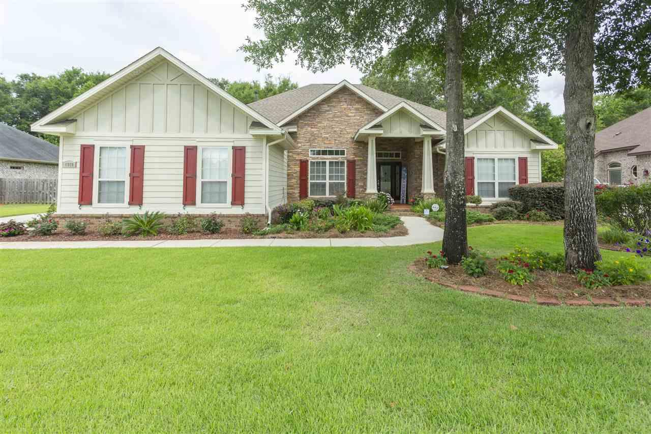 Nature Trail Beauty is a one owner, former Parade of Homes model home that is Move In Ready. It has a three- car side entry garage with lots of storage. Main living area has beautiful hardwood floors throughout. Get ready to welcome your friends through the grand foyer. Three bedrooms are located at the front of the house and one of the bedrooms has a full bathroom. Living room is open and spacious for gathering with friends and family and features a built in gas fireplace, recessed lighting and surround sound. Crown molding adds an extra touch of class throughout. Delight in the Gourmet Cooks Kitchen as you test your chef skills out on the stainless steel, executive five burner gas double oven/stove. Appliances are stainless steel, with bu