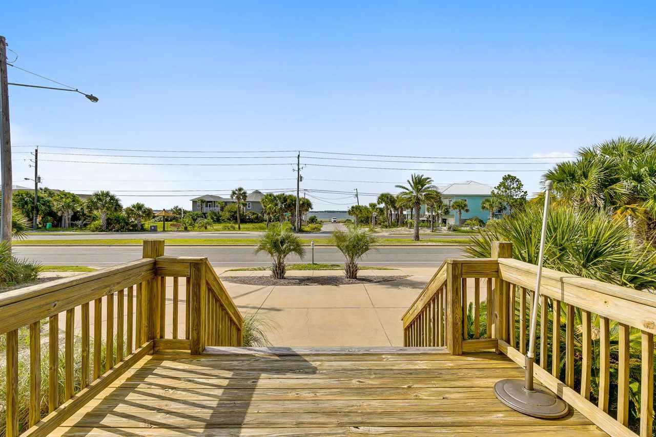 Relax from your dining room or front deck and enjoy the unobstructed views of the Sound or the Gulf from the rear decks with this beautiful 3 bedroom - 3 bath beach house.  Plenty of windows and 3 decks let the light in and allow for great settings. Easy access to the Gulf and 1289 sf of outdoor living space with a private outdoor shower and fenced back yard.  Completely remodeled in 2004 with additional updates recently including a NEW ROOF and NEW ICE MAKER. Split level provides privacy and separation with spacious rooms. Large kitchen features stainless steel appliances, granite, multi-level bar for meal prep and casual dining, over and under cabinet lighting, custom tile and backsplash, cabinets and storage including a lighted hutch wit