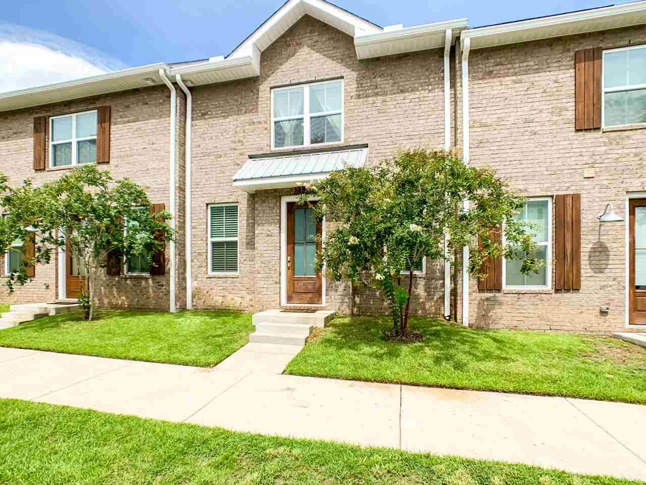 Downtown living at The Junction at West Hill!  Luxury vinyl flooring downstairs and primary bedroom.  Stainless appliances, Granite counter-tops, recessed LED lighting, single car garage.  Impact windows, and 8 foot exterior doors. Stainless appliances. Small fenced backyard for the doggy. Indoor Laundry hookups. Smart home features. Only a 5 block walk to downtown Pensacola!!