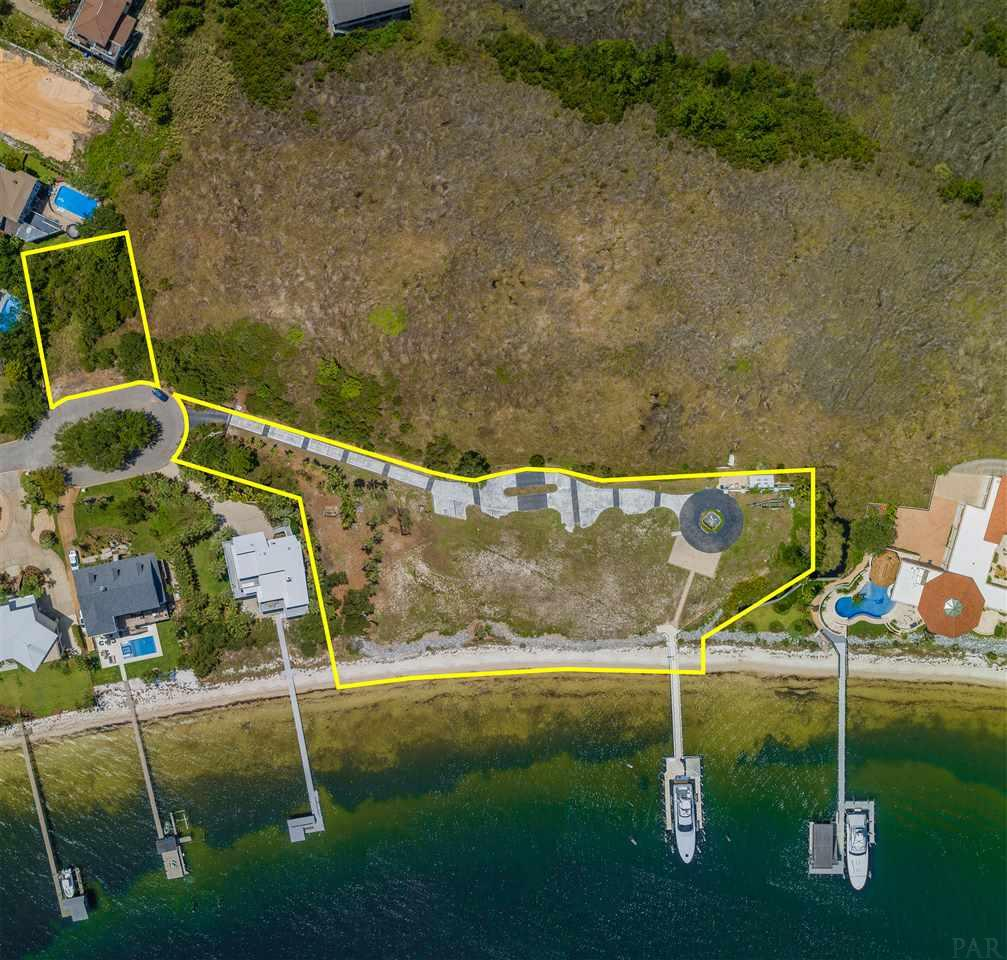 Build the home of your dreams on Pensacola's premier estate. This gated oasis is surrounded by 29 acres of preservation area creating unmatched privacy and tranquility. Facing south towards Pensacola Beach with 300 feet of white sandy beach and water frontage allows this property to takes advantage of the cool southern breezes and panoramic views. 533 Deer Point Dr. is a yachter's haven with its private deep-water port. Already in place is a one of a kind commercial-grade dock built out of all concrete. This dock includes two large slips one of which has a lift rated for over 100k pounds. Located just outside of your gated entry is a beautiful .25-acre guest lot that accompanies the main property. A combination like this may never be available in the Pensacola again as this is the most prestigious waterfront parcel ever offered in our area.  -533 Deer Point Dr. & guest house parcel 09-3S-29-0910-00A00-0180 included in the sale