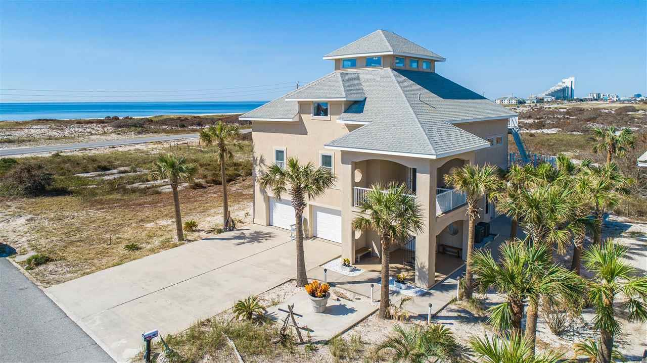 With magnificent Gulf views nestled on Perdido Key, this nautical fortress is built with ICF (Insulated Concrete Form) construction, steel framework and concrete pilings, 3 levels of poured concrete floors and an elevator to the second level. You'll enjoy the public beach access directly across the street and countless sunsets and views of Ol' River and the Gulf from the sunroom and top sundeck on the 3rd floor with protected views of Perdido Key State Park. The sunroom is encompassed with cork walls and all sliders open to enjoy the open air. The spacious living area has vaulted ceilings which flows into the dining area and kitchen. The kitchen comes equipped with granite counter tops, island and ample cabinet storage and counter top space. The spacious master suite has Gulf views from the bed and comes equipped with an oversized walk-in closet, sitting area/gym/office space and the master bath has a large jetted tub with heater, encompassed with granite, double granite vanity and separate walk-in shower. Also on the 3rd floor, you'll find a spiral staircase that leads to the 4th bedroom on the 4th floor, with 360 views and ample natural light. The 2 additional bedrooms and bathroom are located on the 2nd floor. The 1st level has a full In-Law suite (or full apartment) with a full kitchen with stainless appliances, full bathroom with walk-in shower, separate laundry, separate side entrance and large covered patio and wheelchair accessible bathroom. Other notables are 2 FULL KITCHENS new roof to be installed, impact glass, 6 inch steel beams built on whole deck, double layered stainless steel flashing, rebar and wire mesh in driveway to prevent cracking, mini split in sunroom, recessed lighting, 2 car garage, generator hook up, termite bond, landscape lighting timers. Just 5 miles to the Galvez public boat ramp and new park on Innerarity point. 6 miles to Zeke's Marina. Check out our full video tour on the MLS and YouTube.
