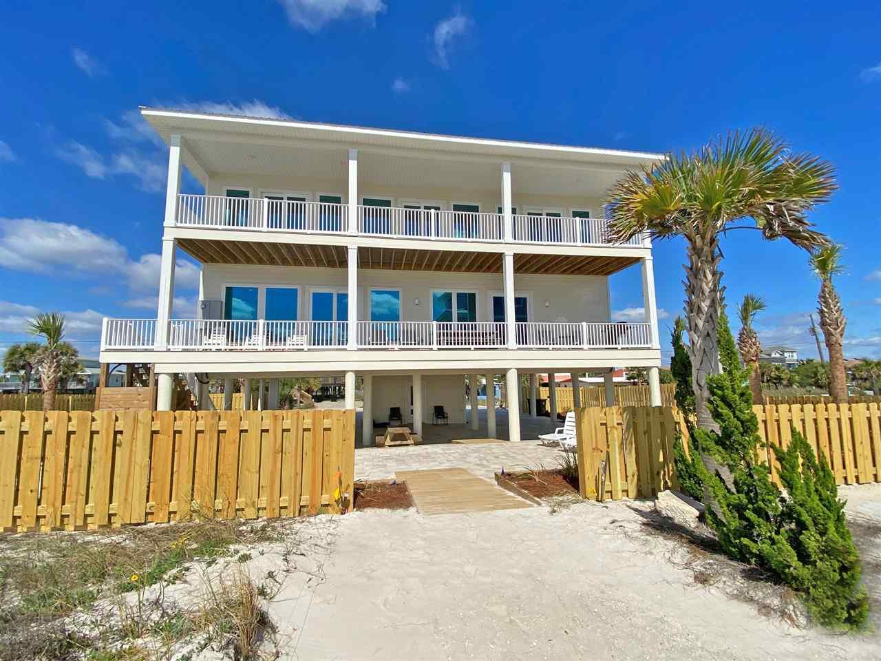 This brand-new contemporary Gulf front home was finished in December 2019. It has incredible Gulf views from every room! This home has six bedrooms & six baths. There is room for large groups to spread out with privacy. There is a large living area on each floor with 65-inch TVs and fabulous views of the Gulf. The house is ADA compliant. The 1st floor has a huge living/dining & kitchen area. The gourmet kitchen has granite counter tops, & stainless-steel appliances, including two dishwashers. A wet bar with a wine/drink cooler is located next to the kitchen area. The two dining tables seat up to 20 people. The kitchen/ breakfast bar seats four. The living area is open, has plenty of seating, and opens onto the 9 x 53 foot covered Gulf front deck. The deck has a big dining table and other seating. There are two bedrooms on this floor. The master suite with a door to the Gulf front deck has a king bed, a queen sleeper sofa. The master bath has double vanity, soaking tub & large shower with a ceiling mounted rain shower and one wall mounted shower. Bedroom 2 has a king bed, and twin bunk bed with views of the Sound & the Gulf. Next to this bedroom is a bathroom with shower which serves this bedroom and the main living area. The upper level of the house features a second, large living area which opens directly to another 9 x 53-foot Gulf front deck. This room (the lounge) has a queen sleeper sofa, comfortable armchairs, and a well equipped kitchenette/bar. There is a 2nd master suite, and another guest room with bath, as well as a 3rd master suite. The ADA compliant bedroom and bath is on this floor. House sleeps 25. There is covered parking for six cars & six on the driveways, & outdoor H/C shower. The yard is fully fenced with a large patio with pavers - the perfect place for parties! The garden is lushly landscaped. This beautiful house, with elevator, garden & 45 X 53-foot, open, covered space under the house, is a perfect vacation rental.