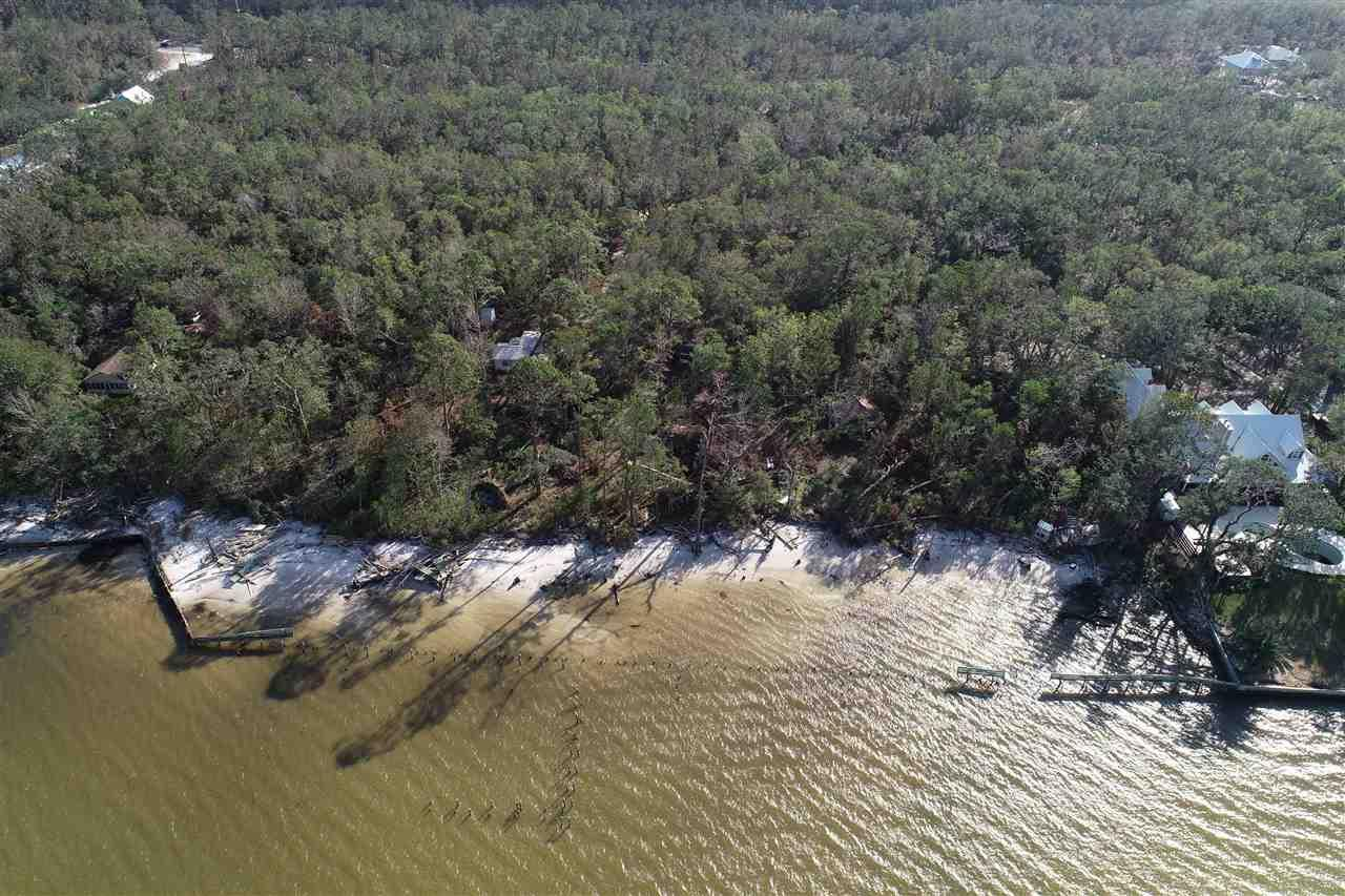 RARE OPPORTUNITY TO OWN 15.5 ACRES ON BON SECOUR BAY!  Family has decided it is time to sell the land that has been in their family since the 1850s.  There are 5 parcels that provide 895' waterfront on Bon Secour Bay and 891' road frontage on Ft. Morgan Hwy.  The property is heavily wooded and the bulk is designated as a Code X Flood Zone.  There are no wetlands on the property nor beach mouse habitat.