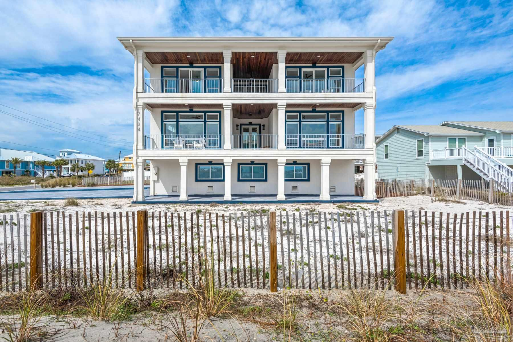 """This one of a kind luxury home is located on Navarre Beach on the beautiful white sands of Santa Rosa Island.  This up and coming location has been Florida's best kept secret, but word is getting out and plans are in the works that makes Navarre Beach the place to be! The grandeur of this newly renovated home boasts all the sophisticated luxury you are looking for.  With water views from every window, and an unobstructed South water view, you can watch dolphins play on the gulf side from the sitting room with extra large windows, or catch amazing sunsets from any of the covered or uncovered porches.  This home has been equipped with so many extras.  The incredible 24""""x24"""" Italian Marble floor on the main level, and this kitchen would make an executive chef envious.  With top of the line appliances, Natural Quartzite on the 9' island and countertops and the open floor plan, cooking in this kitchen is a pleasure.  With so much to see and admire, don't forget to look up at the marvelous custom made chandelier that is the star of the living area,  a wench was installed for ease of maintenance. There are two bedrooms that could serve as the master bedroom, one on each floor.  There is an additional 3rd bedroom with an en suite.  Some not so obvious extras are the porch's custom solid aluminum rails with automotive finish, whole house water purification system, air scrubbers attached to both AC units for air purification, three water heaters, whole house surge protectors, the list goes on and on.  All of this on a large lot with room for a pool, a quick and easy 100 yard walk to the pristine white sand beaches and just 500 yards to the award winning Gulf Island National Seashore. Call today to make your appointment to see this spectacular property! Be sure to click on the first Virtual Tour and """"walk through"""" this home with the convenience of the matter port virtual tour."""