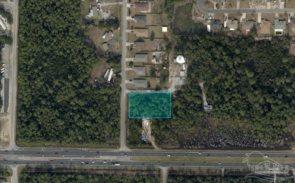 Excellent +/-.78 acre Single Family Residential lot available in Navarre, FL. The parcel is located along Navarre Parkway, which is the main arterial in Navarre, FL. The Navarre and Pensacola markets are best known for having miles of the nations most beautiful, white sand beaches and large government/military presence. The surrounding areas continue to grow as this is a large tourist destination and also bringing in many new job opportunities. The area is estimated to grow at a rate of 6% annually. Top-rated schools, quality health care, and a stable economy make Navarre a great location to not only visit, but also call home.