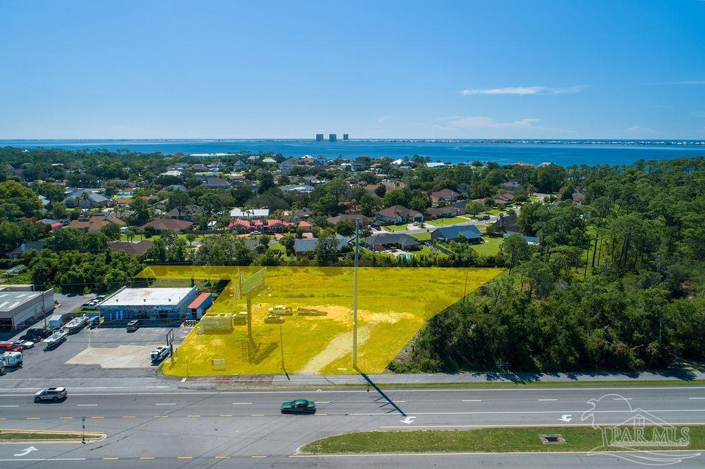 Development ready parcel in Gulf Breeze adjacent to Naval Live Oaks Preserve.  Landscape buffer and retention pond in place.  Architectural/Engineering plans have been completed for building and parking lot.  This sale includes the small adjacent parcel 36-2S-29-0000-00608-0000.