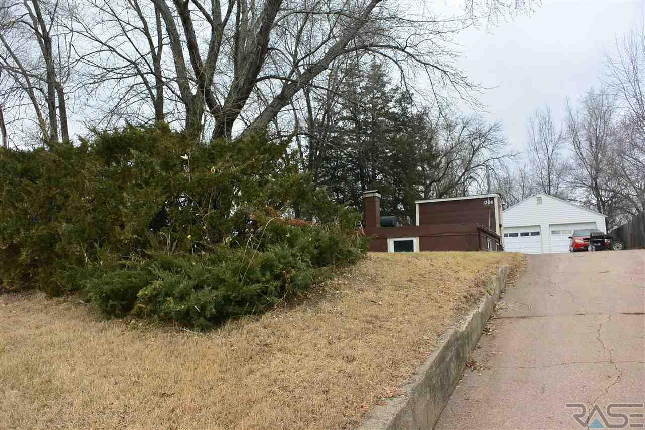 Well maintained 2 bedroom home in a great location.    Nice yard with a 24 x 24 double garage.  Newer roof, interior paint, carpet and ceramic floors.  Newly remodeled bathroom.
