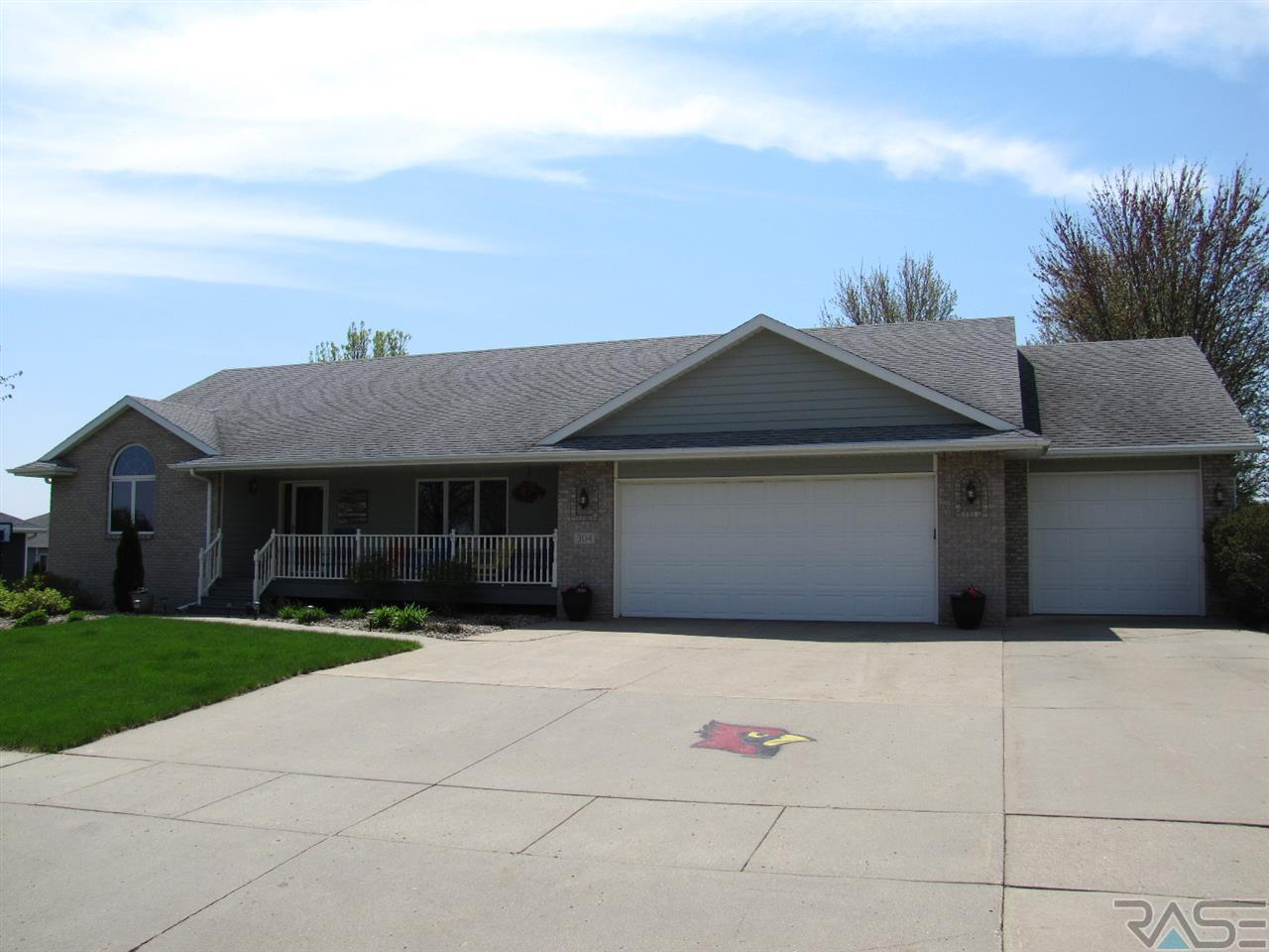 Wonderful place to call home.  This tastefully decorated home features 4 bedrooms, an office or toy room, 4 baths, main floor laundry, spacious updated kitchen with Cambria counter tops, tile floor and backsplash, lighting and stainless steel appliances, the kitchen is open to the dining room with gorgeous hardwood floors,  formal living room, and custom built ins.  The master bedroom features a large walk-in closet and master bath. The lower level boasts 2 spacious bedrooms with ample storage, a full size bath, an office/toy room, and a wonderful family room with a newer gas fireplace to cozy up too.  You'll love the oversized 3 stall garage room for everyone including the toys. Outdoor features include a deck leading from the dining room, and a paver patio to entertain guests in your new outdoor kitchen.  If you prefer you can also enjoy that final cup of coffee for the day from the covered front porch. Nothing to do but move in. Don't wait - Call your favorite agent today!