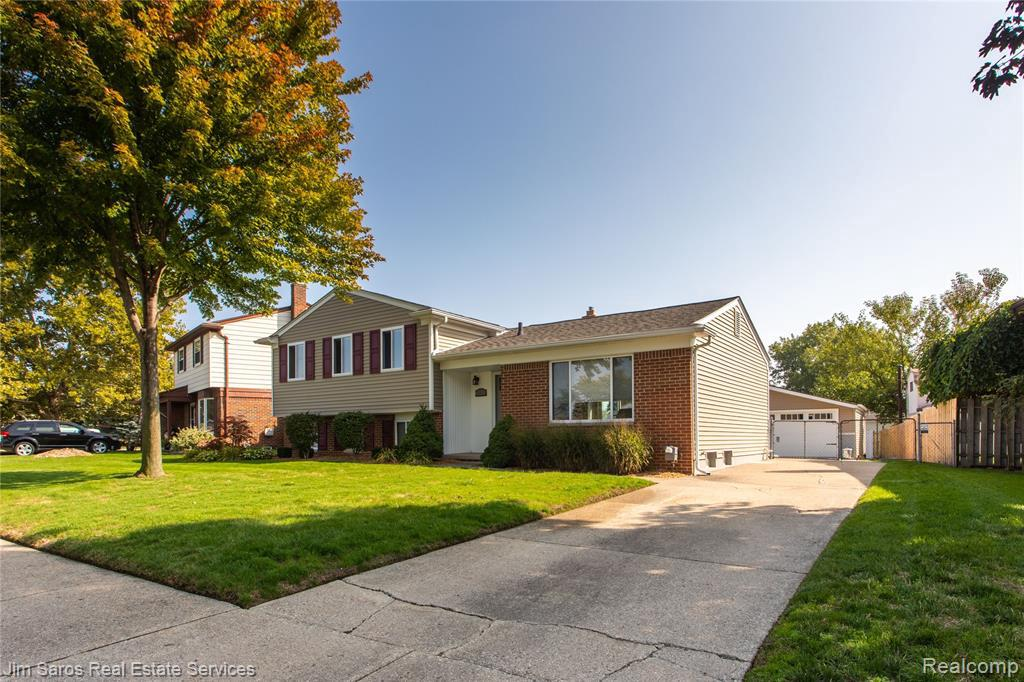 Beautiful remodeled four bedroom Quad level home in the Utica School District. Updates in this home from 2019 include brand new kitchen, 150 Amp electrical panel w/ generator hook up outside, and door-wall leading to Trex deck. A 50 gallon HWT, garage door, vinyl siding on garage in 2018, and vinyl siding on house in 2016. New roof in 2014 w/transferable warranty, furnace and a/c in 2013, and windows in 2008. This home also features a large backyard with privacy fencing all around, and sprinkler system in front and back. Close to M-59, M-53, restaurants, and shopping. *Buyers & Realtors, please practice social distancing, no more than 4 people in the house at a time, please remove shoes, sanitize upon entering and exiting the home (sanitizer will be provided), keep touching to a minimum, and leave all lights on in the house.*
