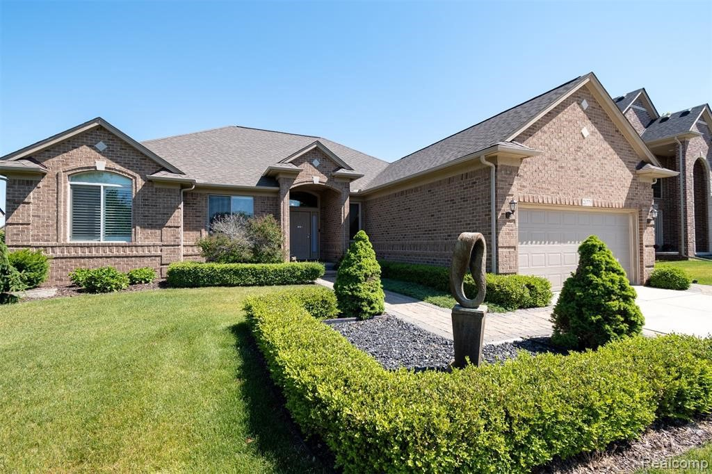 Stately full brick ranch home in Macomb Twp. is move-in ready! Professionally landscaped yard with paver patio and sprinkler system. Great room features high volume ceiling and gas fireplace with custom mantle. Spacious eat-in gourmet kitchen with granite counters and island, stainless steel Viking appliances, raised panel 42 inch cabinets, and bay door wall. Master bedroom with ¾ inch hardwood floors (2020), generous walk-in closet, and bay window. Master bath includes soaker tub, separate full shower, and double sink with granite counter. Additional bedrooms each have ¾ inch hardwood (2020). Formal dining room with crystal chandelier. First floor laundry with storage closets. Basement is expertly finished and boasts a custom designed bar with granite counters, a half bath, and ample storage. Custom window treatments throughout the home. No association fees and fences are permitted. Sale contingent upon seller finding new home.