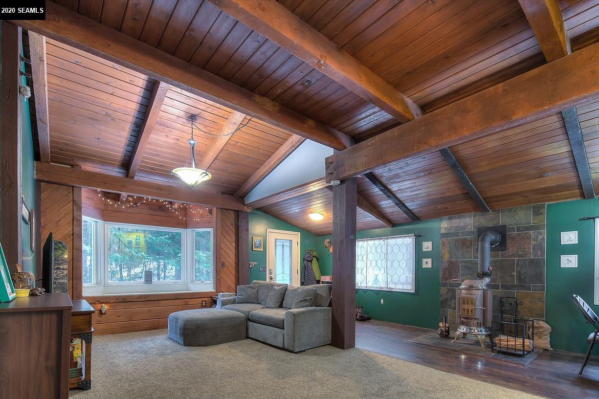 Open floor plan. Vaulted ceiling. Bay window with views of Thunder Mountain.