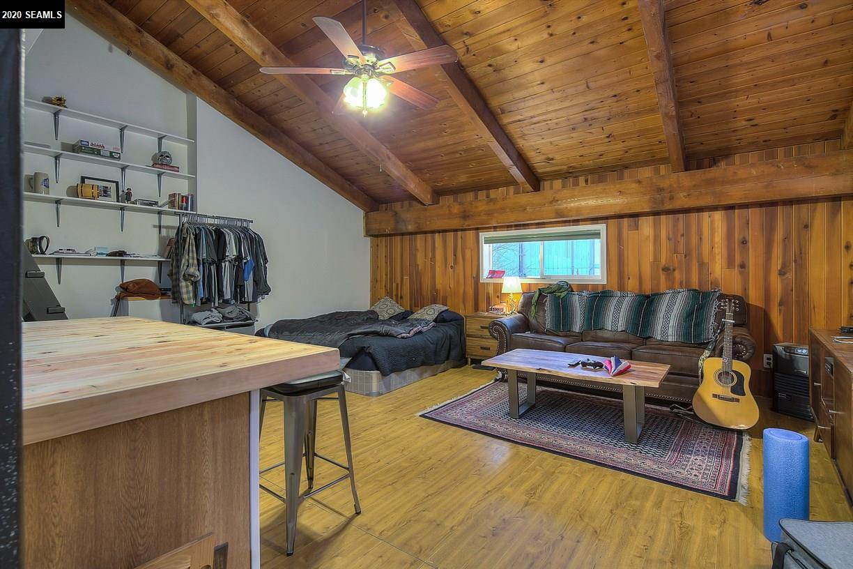 Spacious living area, a loft too. Large wood kitchen island. Vaulted ceilings.