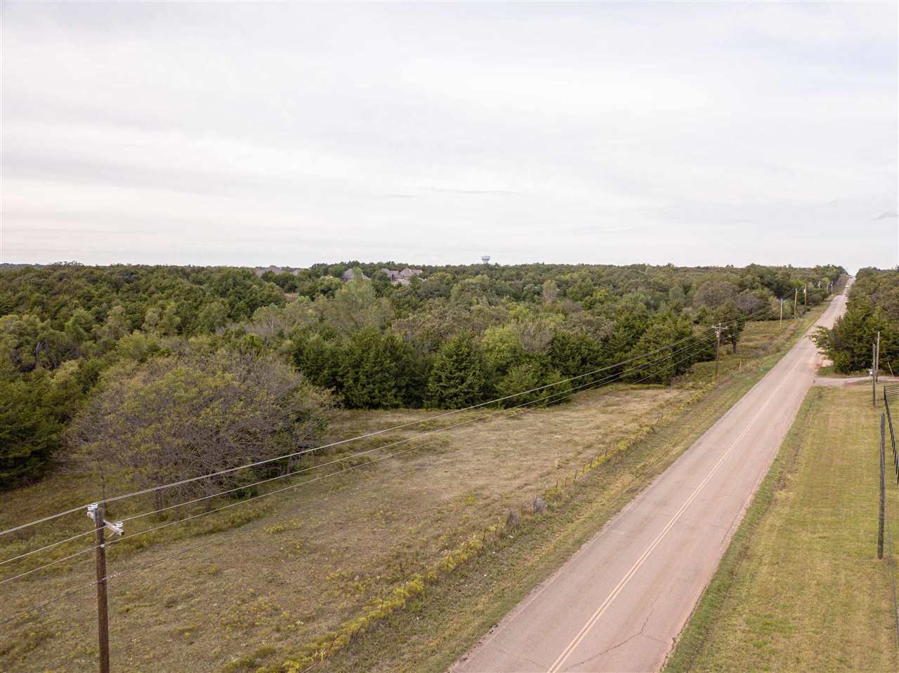 Location, location, location. This fantastic 32.17 acres now available with endless possibilities for this piece of land and pave road access in SW Stillwater. Whether you want to build, have a place for cattle/horses or just enjoy having land, do not miss your opportunity. This property is located on S Country Club Road, between 44th and 56th, south of Red Rose Valley. Stillwater Schools District. The property has already been surveyed with pins set. The land is a combination of pasture land and trees. 5 strand fencing on majority of property. Utilities are along Country Club Road. Call for your private showing today!