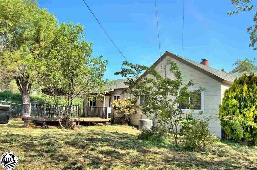 The home is situated on a large, level, corner lot