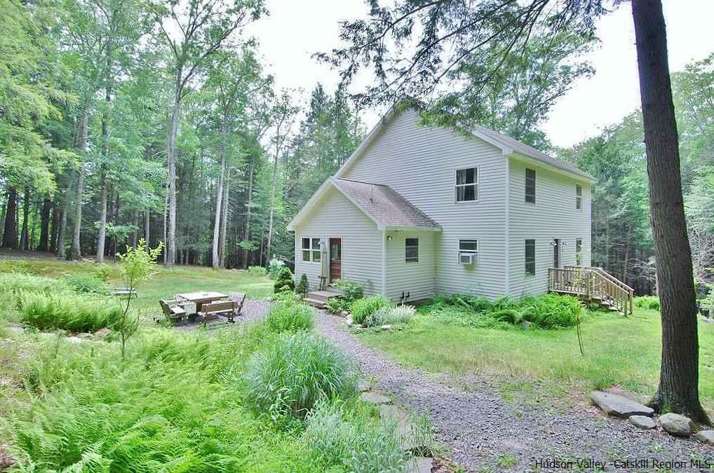 Total Seclusion! Take a scenic route along the reservoir and arrive at this beautiful 3 bedroom 2 bathroom Colonial.  This home sits on 7.50 acres on both the Esopus creek located on the southerly end and the Stony Kill Creek which is  the westerly border.  Property is surrounded my mature trees, and is beautifully landscaped with perennials.  During the summer months enjoy the babbling brook while entertaining friends and family on newly constructed wooden deck.  This 2100 square feet sun filled home has an open concept living room and kitchen. Kitchen is designed with an arts and craft flare---meticulously handcrafted from pine boards the home is impeccable! Other features are Mexican tiles throughout foyer and kitchen. Radiant heat is throughout the first floor and basement.  Enjoy a warm bath in the claw foot tub in the upstairs bathroom or your own infrared sauna in separate loft.  This home has additional rooms waiting for your finishing touches.  Plumbing is in place in unfinished bathroom upstairs.  Additional heating source outside for those cold winter months.  Don't miss out on this hidden gem!