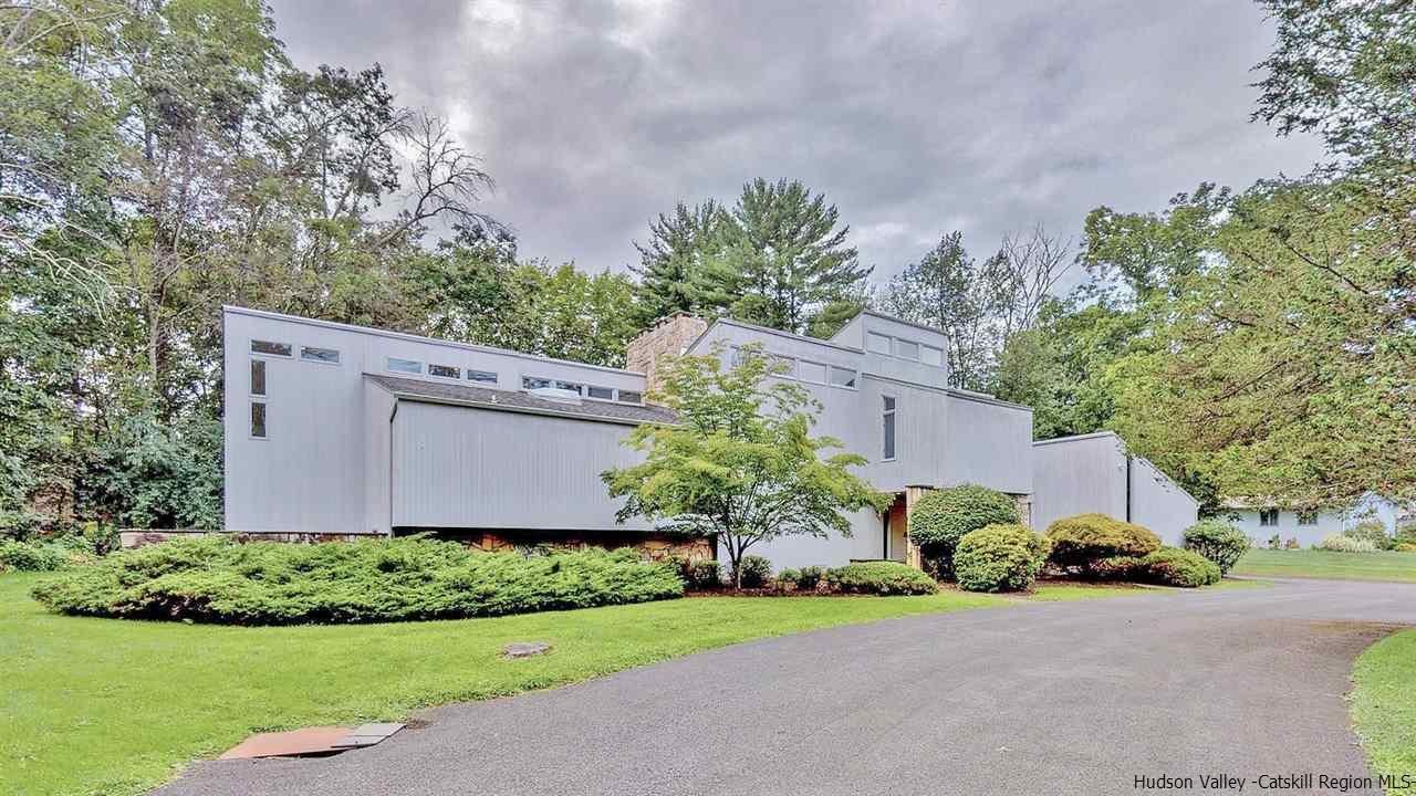 Custom contemporary home sited on an expansive double lot fronting the exclusive Wiltwyck Golf Course. Drive you own golf cart to play, lunch, dinner or the pool, just like owning your own resort in your backyard. A very demanding exterior mixing ceder wood siding and bold rock accents. Step inside to a modern dream offering multiple raised and lowered entertaining rooms, multiple fireplaces and a wall of windows overlooking the expansive yard and golf course.  Built in the mid 70's the homes style has come full circle offering wonderful modern accents and touches. There master suite is just a few steps up from the first floor, a towering vaulted ceiling and sliders to a private deck are just a few dramatic features, a dressing room and a mirror lined bathroom await with soaking tub and private shower, just off this bath is a large exercise room with Jacuzzi also leading out to the back deck.  Three more bedrooms are on the second floor, one with a private bath and balcony overlooking the front yard.